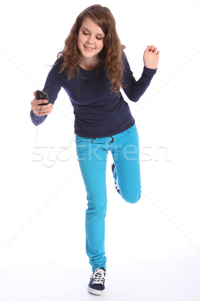 Stock photo: Dance fun to music teenage girl and cell phone
