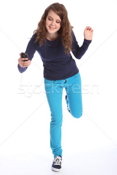 Dans leuk muziek tienermeisje mobiele telefoon dansen Stockfoto © darrinhenry