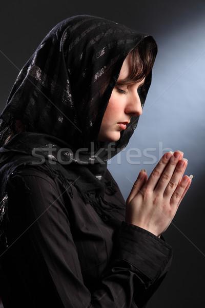 Beautiful woman in headscarf praying eyes closed Stock photo © darrinhenry