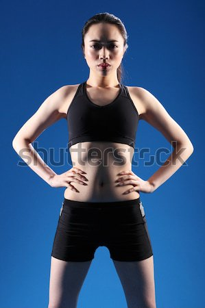Oriental Asian woman back stretch on exercise ball Stock photo © darrinhenry
