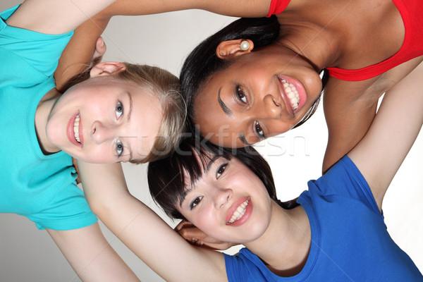 Happy group huddle by mixed race student girls Stock photo © darrinhenry