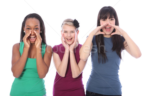 Three mixed race teenage girls shouting out loud Stock photo © darrinhenry