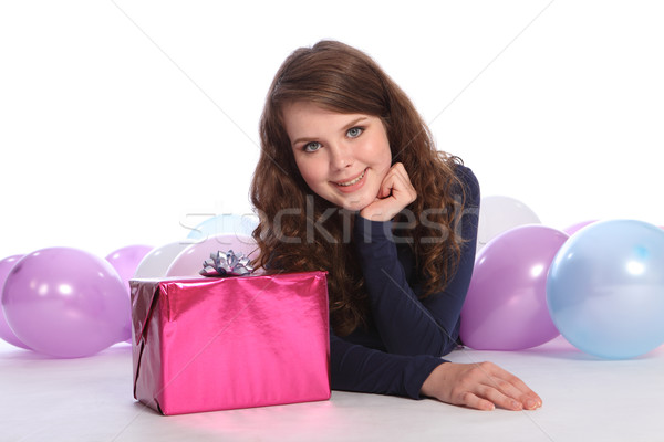 Stock photo: Beautiful teenager girl birthday party with gift