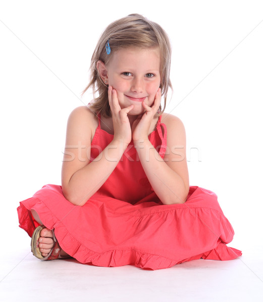 Cute primary school girl sitting cross legged Stock photo © darrinhenry