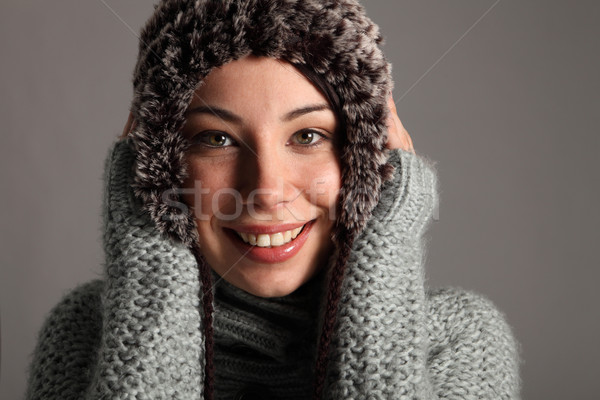Beautiful young girl in winter wool jumper and hat Stock photo © darrinhenry