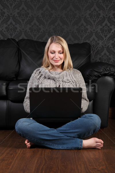 Young woman on floor at home surfing internet Stock photo © darrinhenry