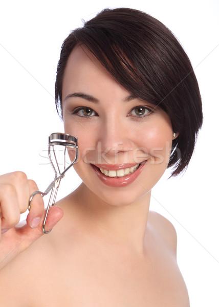 Smile by beautician woman using eye lash curler Stock photo © darrinhenry