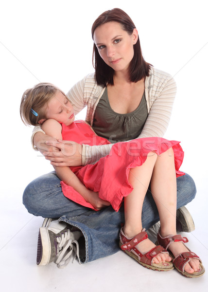 Mother holding sleeping daughter with love Stock photo © darrinhenry
