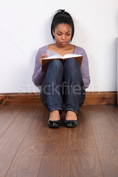 Young black girl concentrating hard reading a book Stock photo © darrinhenry