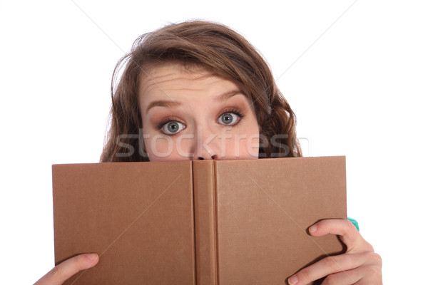Teenager girl with blue eyes reading a book Stock photo © darrinhenry