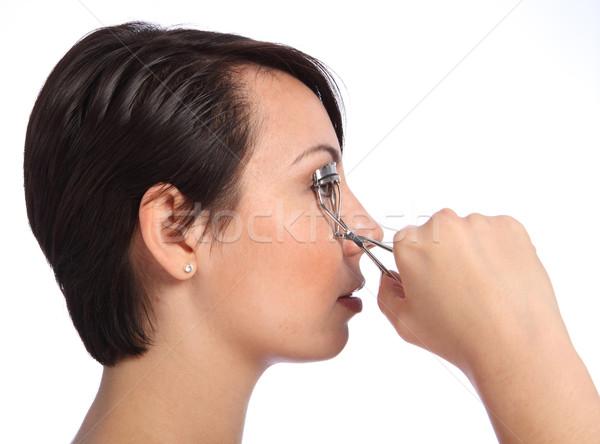 Beautician woman using eye lash curler in make up Stock photo © darrinhenry