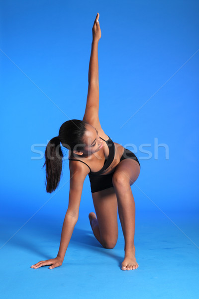 Fitness warm up stretch by fit African woman Stock photo © darrinhenry