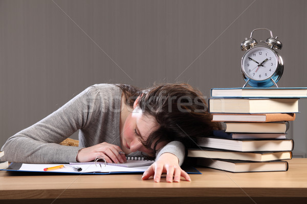 Student falls asleep doing homework late at night Stock photo © darrinhenry