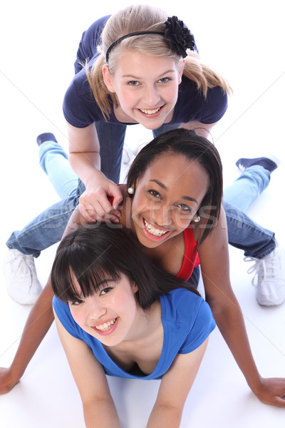 Three mixed race girl friends having fun together Stock photo © darrinhenry
