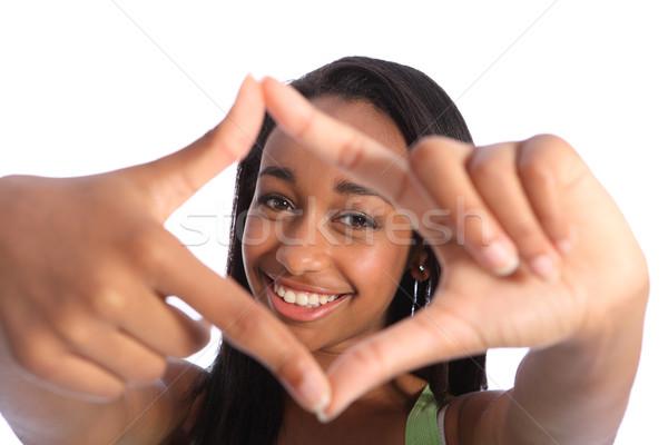 Mooie zwarte tienermeisje leuk hand frame Stockfoto © darrinhenry