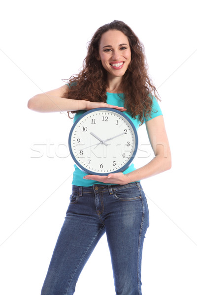 Time keeping beautiful young woman holding clock Stock photo © darrinhenry