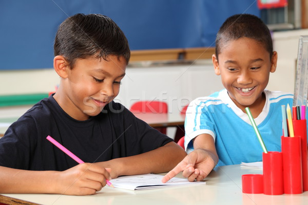Two happy school boys enjoying and sharing learning in class Stock photo © darrinhenry