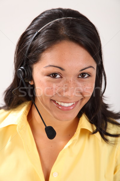 Bastante sonriendo femenino recepcionista auricular Foto stock © darrinhenry