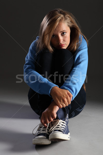 Scared teenager girl on floor stressed and alone Stock photo © darrinhenry