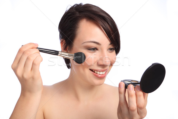 Happy beautiful woman using make up blusher brush Stock photo © darrinhenry