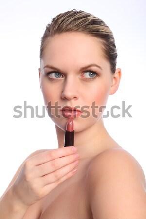 Beautiful naked woman using red lip stick make up Stock photo © darrinhenry