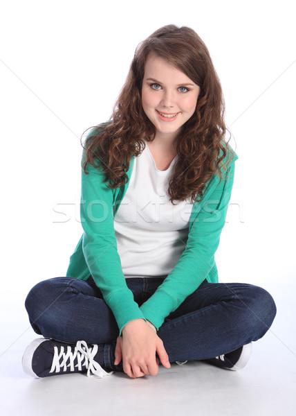 Happy teenage student girl sitting cross legged Stock photo © darrinhenry