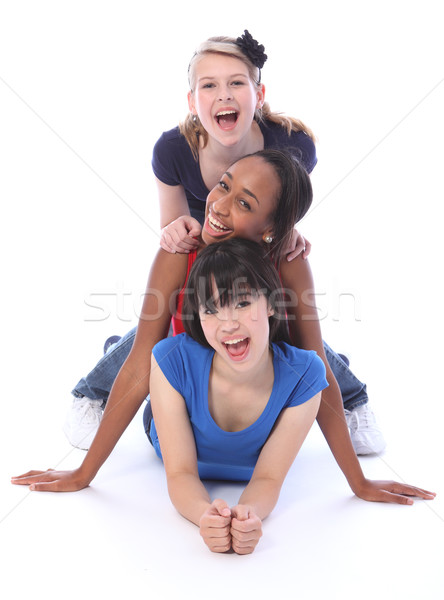 Happy multi ethnic girl friends human totem pole Stock photo © darrinhenry