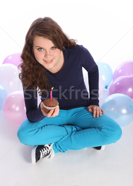 Stock photo: Celebration time for teenager girl chocolate cake