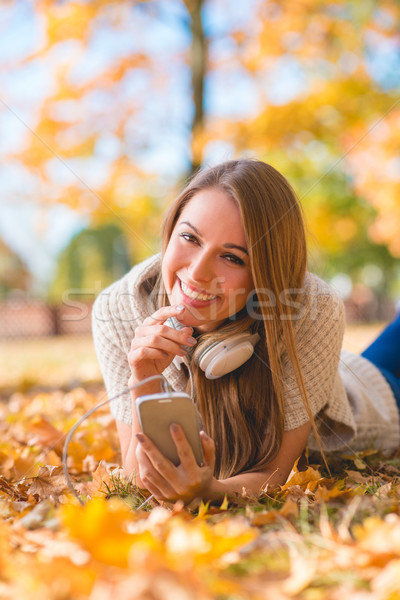 Cute young woman with a lovely warm smile Stock photo © dash
