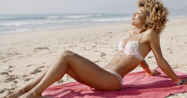 красивая женщина солнечные ванны пляж женщину воды Сток-фото © dash