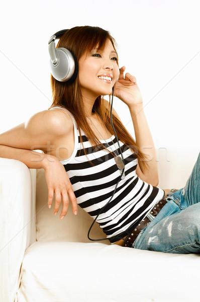 Ouvir música jovem asiático belo mulheres música Foto stock © dash