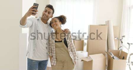 Ecstatic young couple celebrating their new home Stock photo © dash