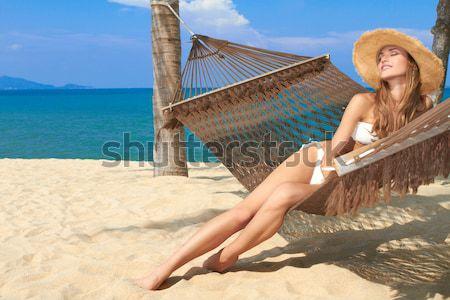 Nő megnyugtató függőágy tengerpart vonzó karcsú Stock fotó © dash