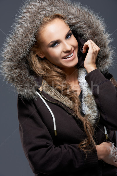 Happy Woman in Jacket with Furry Hood Stock photo © dash