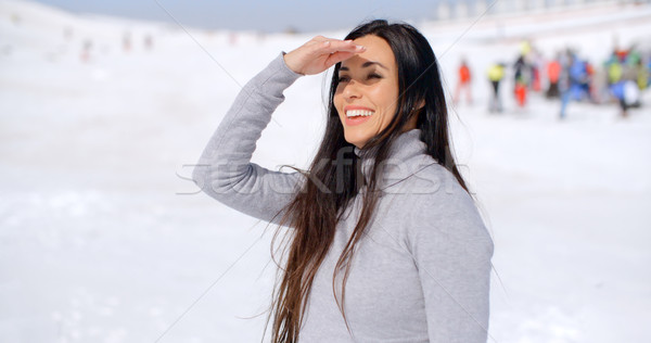 Gorgeous smiling young woman at a ski resort Stock photo © dash