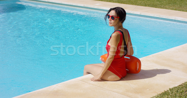 Watchful lifeguard sitting at side of pool Stock photo © dash