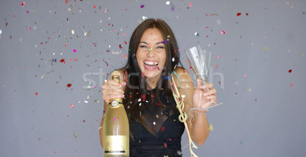 Laughing vivacious woman celebrating the New year Stock photo © dash