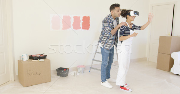 Handsome husband helps his wife wearing overalls Stock photo © dash