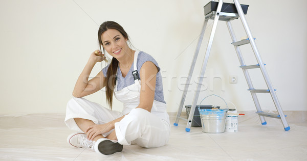Pretty young woman renovating her home Stock photo © dash