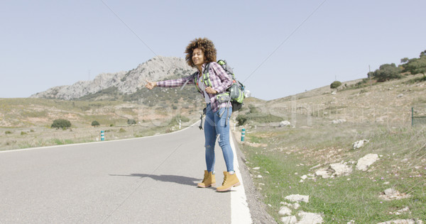 Young female tourist hitch hiking Stock photo © dash