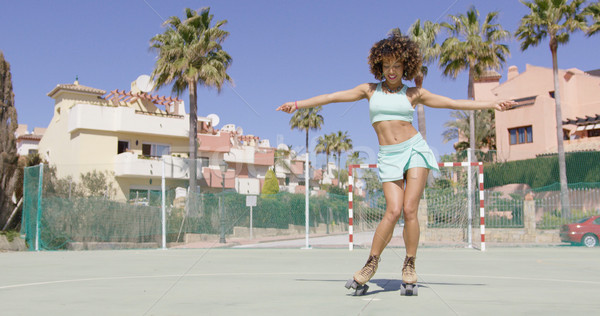 Young pretty woman dancing in roller skates Stock photo © dash