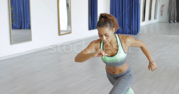 Concentrated sportswoman doing exercise Stock photo © dash