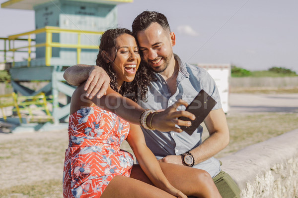 Stock photo: Excited couple taking selfie on seafront