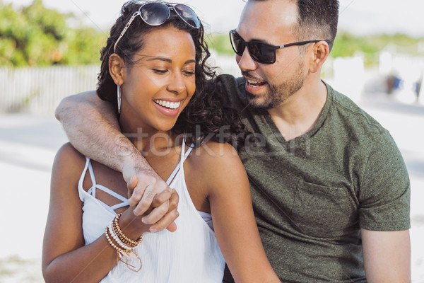 Beautiful couple embracing on shoreline Stock photo © dash