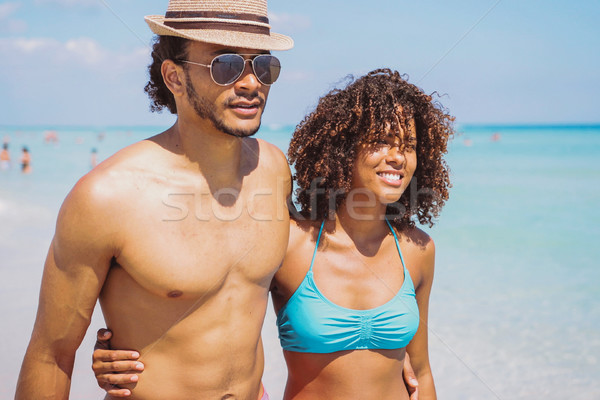 Ethnic couple embracing at seaside Stock photo © dash