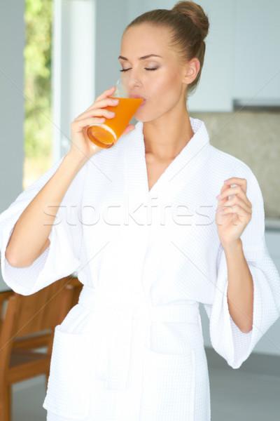 Woman enjoying a glass of orange juice Stock photo © dash
