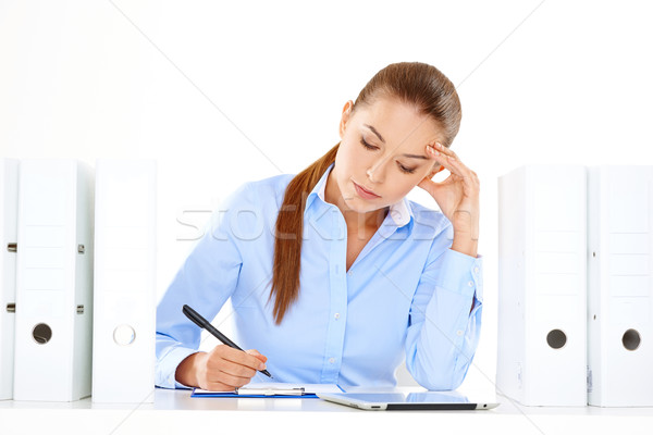 Efficient businesswoman working at her desk Stock photo © dash