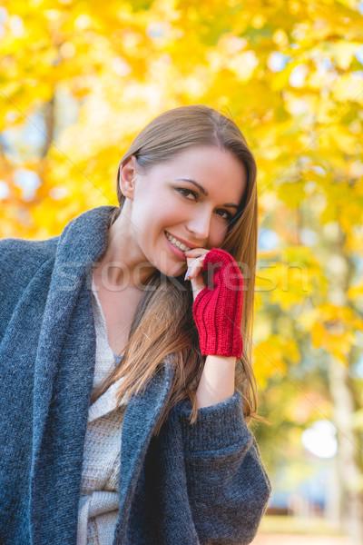 Young woman in a colorful autumn garden Stock photo © dash