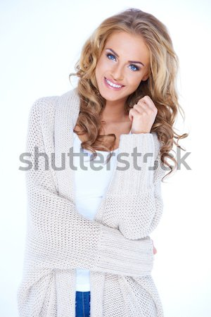 Happy Blond Woman in Knit Cardigan Looking Up Stock photo © dash