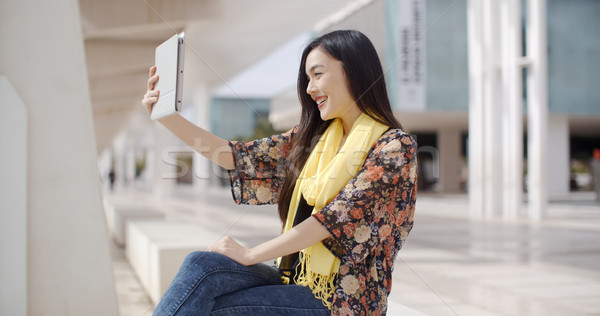 Woman taking a self portrait with tablet Stock photo © dash